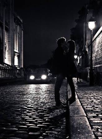 Couple kissing under streetlight